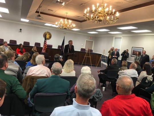 Virginia Gov. Terry McAuliffe talks to a group on Friday,
