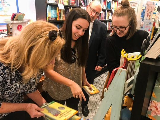 Volunteers select books to donate to Children's Home Society library.