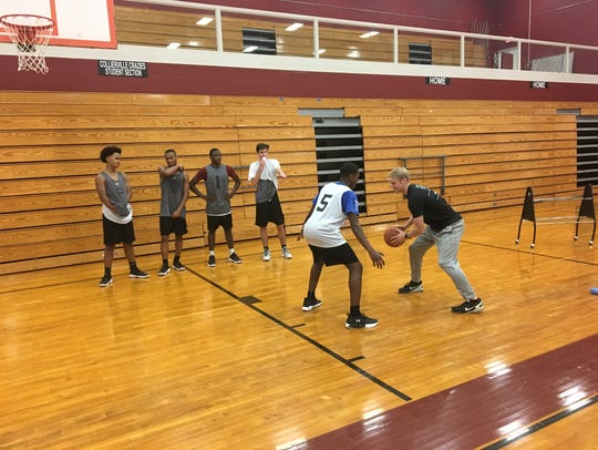 Ty Greene showing players a drill at Collierville High