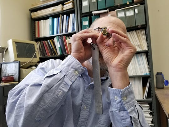 Tim Paulsen looks at zircon crystals.