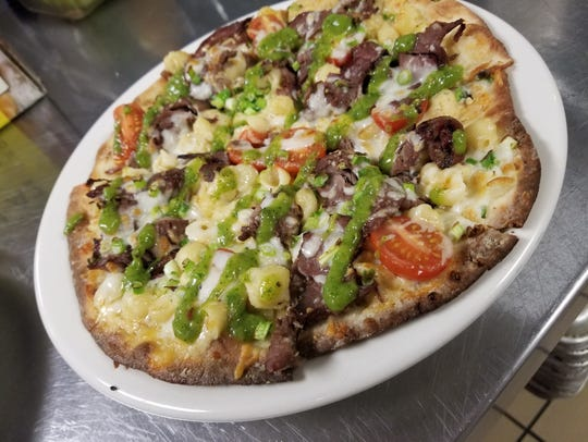 The steak mac n' cheese pizza at the Iron Grille restaurant