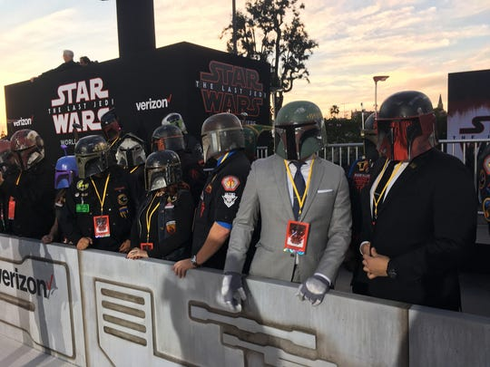 "Costumed fans line up outside the premiere of ""Star Wars: The Last Jedi"" at the Shrine Auditorium in Los Angeles on Saturday, Dec. 9, 2017."