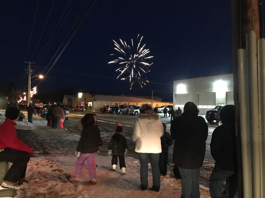 A crowd watches the fireworks before the parade starts in Rudolph