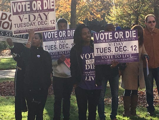 Catrena Carter and her family attend a get-out-the-vote