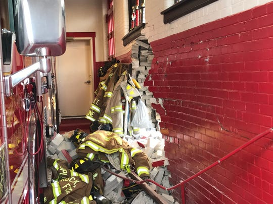 A view from inside the Rockaway fire house after an accident in which a Jeep crashed through the side wall of the station on East Main Street. Dec. 11, 2017