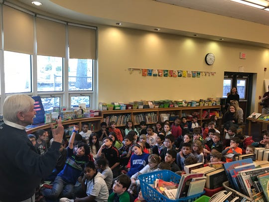 Children's book author Joe Brown, father of beauty and makeup expert Bobbi Brown, visits Bradford School in Montclair on Monday and reads to third-graders.