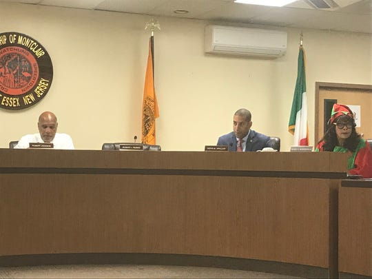 Montclair Mayor Robert Jackson along with Township Council members Sean Spiller and Renee Baskerville, listen to speakers during the Dec. 5 council conference meeting.