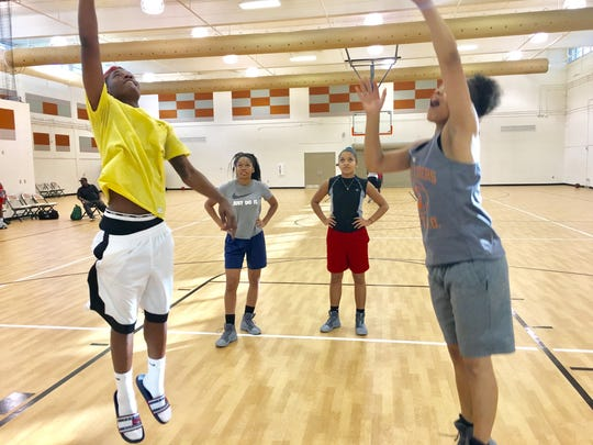 Dunbar senior Ja'miah Bland (left) competes in a shooting drill with senior Sinthia Brown Wednesday, Dec. 6, 2017 at Dunbar. Both missed the 2016-17 season with ACL tears.