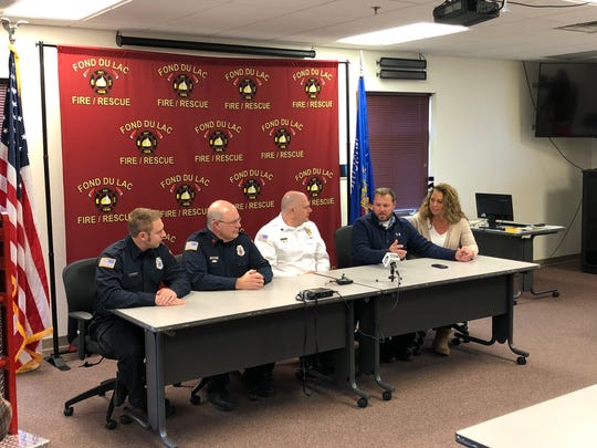 Pictured are members of Fond du Lac Fire/Rescue and the Lorenzs, from left: Tennessen, Hicken, Assistant Chief Todd Janquart, Jeffery Lorenz and Susan Lorenz.