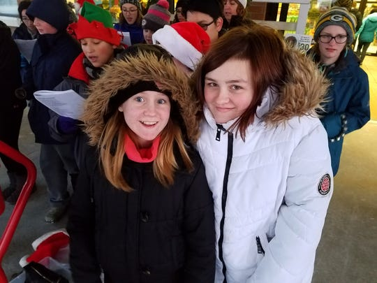 Horace Mann Middle School students ring bells and sing carols to help raise money for The Salvation Army on Dec. 7 at the Bridge Street Pick 'n Save store.