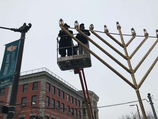 Left, Rabbi Yacov Borenstein helps with the Menorah lighting at One Civic Plaza in the City of Poughkeepsie last year.