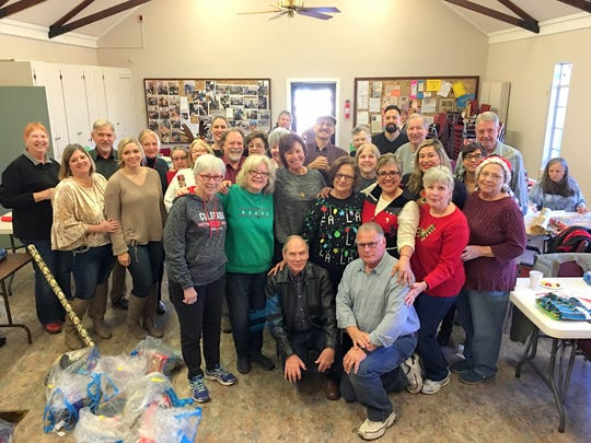 The volunteers gathered for a quick photo during a break in wrapping packages Dec. 9.