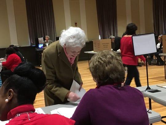 Henrietta Boggs-MacGuire prepares to vote Tuesday at