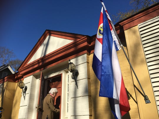 Henrietta Boggs-MacGuire, a former First Lady of Costa Rica, returns home. The Costa Rican flag hangs outside her door.