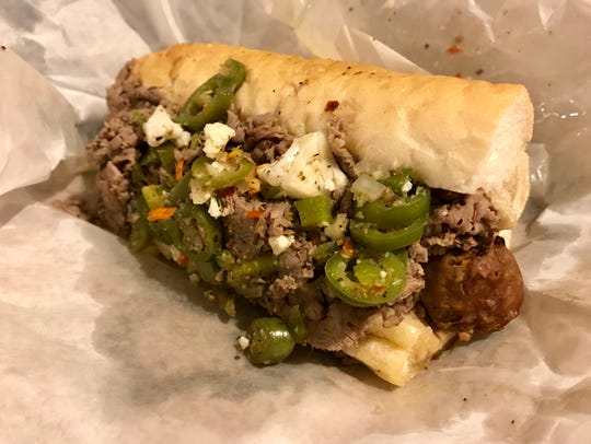 The Combo, an Italian sausage topped with Italian beef,