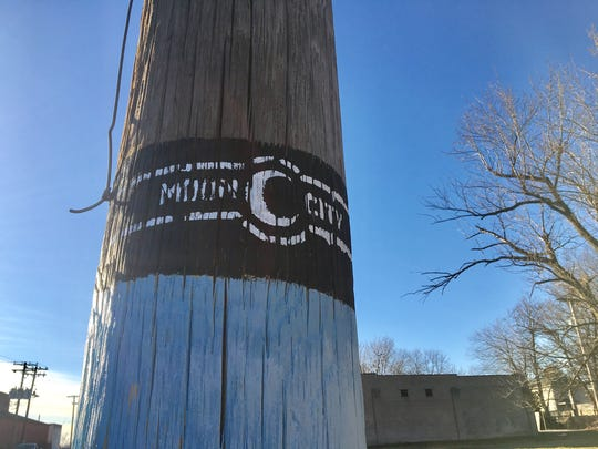 "Some of the telephone poles have been painted with what's called the Moon City ""cigar band."""