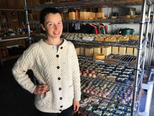 Grace Malloy poses with racks of her goats'-milk soaps