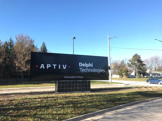 A sign in Troy displays the names of both Aptiv and