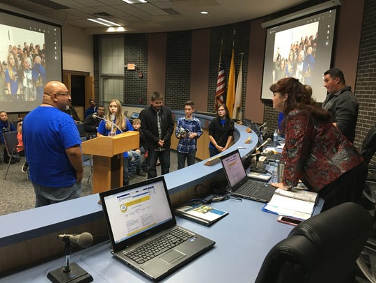 Blanco Elementary School sixth-grade teacher John Gutierrez and members of one of the school's Lego robotics teams deliver a presentation to Bloomfield School District Superintendent Kim Mizell and school board President Dale Maes at a meeting on Tuesday.