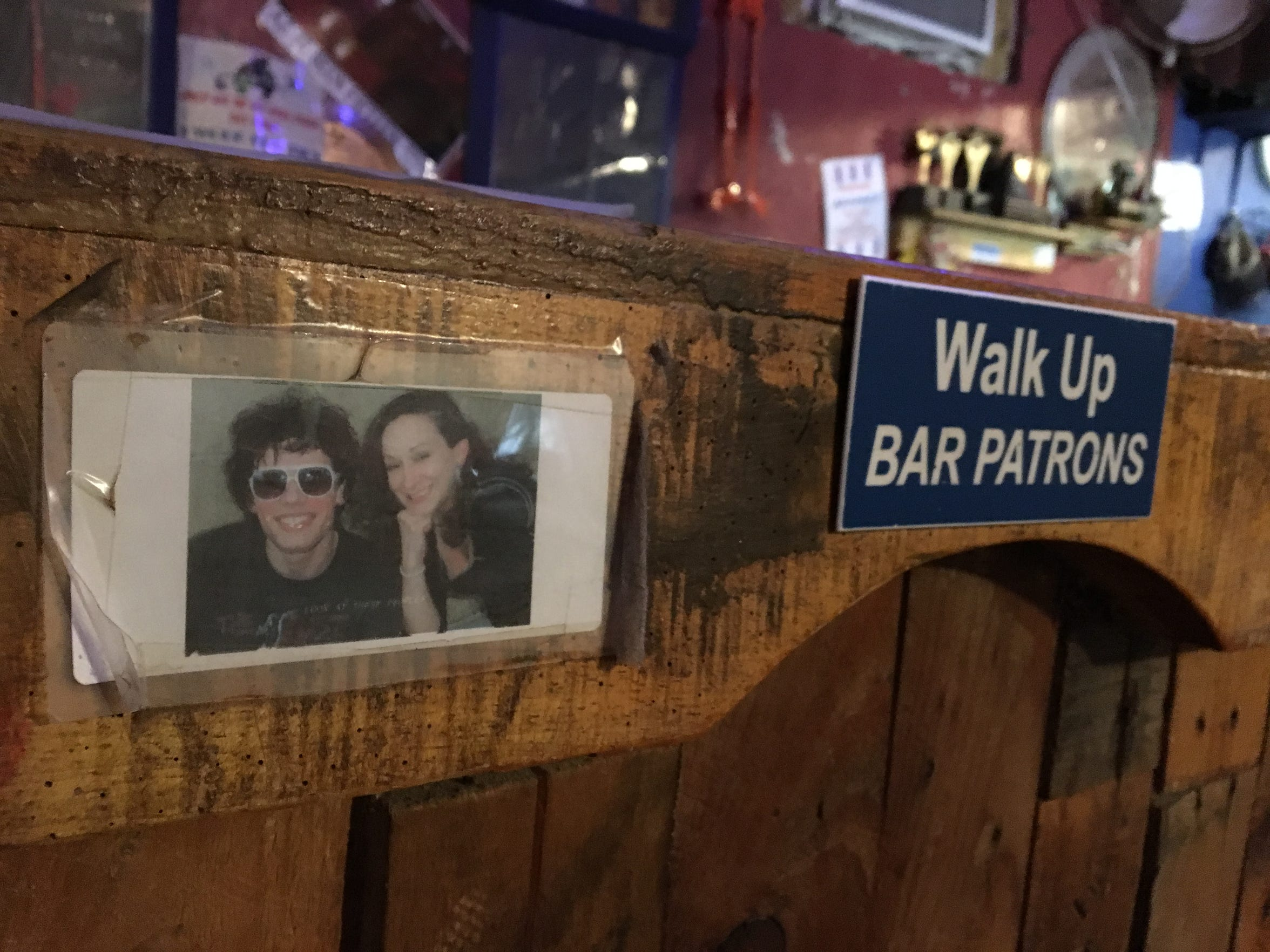 """A photo of Jennifer """"Casey"""" Norred on a bar counter at the Bradfordville Blues Club."""