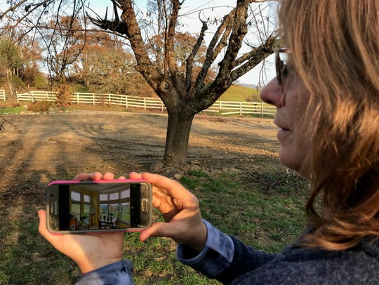 Cassie Taaning-Trotter shows a photo of her home in