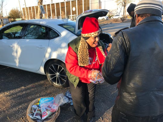 "Janice ""Pinky"" Whitner, of the Pink Mailbox Street Ministries, serves soup and cornbread on West Washington Street in Greenville on a recent afternoon."