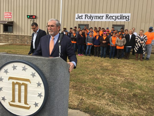 Jet Polymer Vice President Brian Denton, left, and Montgomery Area Chamber of Commerce board chair David Reed gather with Jet Polymer employees Friday at the plant.