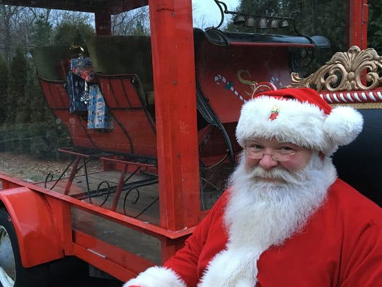 Jim Mitchell sits next to his sleigh at his home in