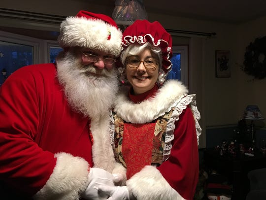 Jim and Yvette Mitchell as Santa and Mrs. Claus in