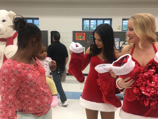 Arizona Cardinals cheerleaders helped spread holiday