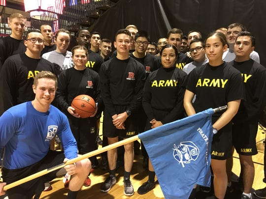 Members of the Seton Hall and Rutgers ROTC unit who ran the game ball 22 miles from South Orange to Piscataway.