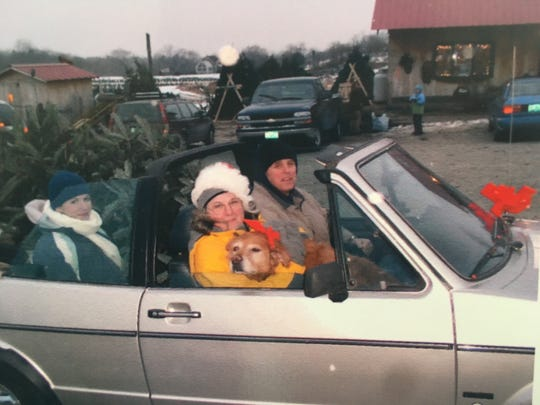 Members of the Shamp family from Jericho are shown in this 16-year-old photo getting their Christmas tree from Whites Tree Farm in Jericho. They used to drive their convertible car to pick up the tree as part of their tradition.