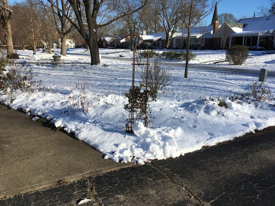 Keeping sidewalks and driveways free of snow reduces