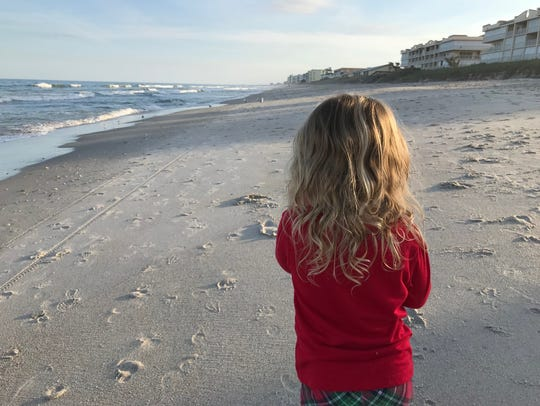 Isabella looks down the beach on a perfect 80-degree