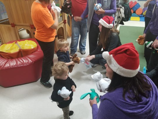 The University of Evansville women's basketball team donated more than 100 new or unused teddy bears Monday morning to the Arc of Evansville Child Life Center.