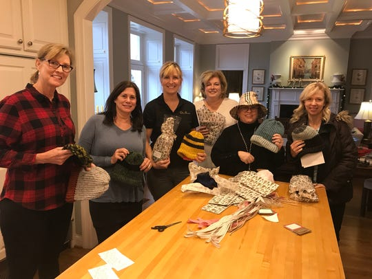 Friends of Sandy Lowe help knit and pack up hats to