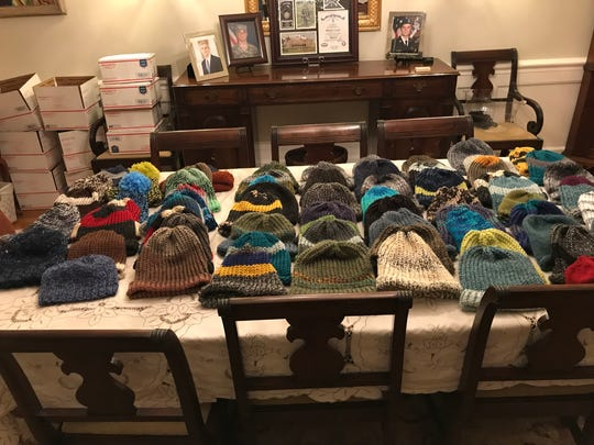 Dozens of hats and boxes lay out before being sent to soldiers in Afghanistan.