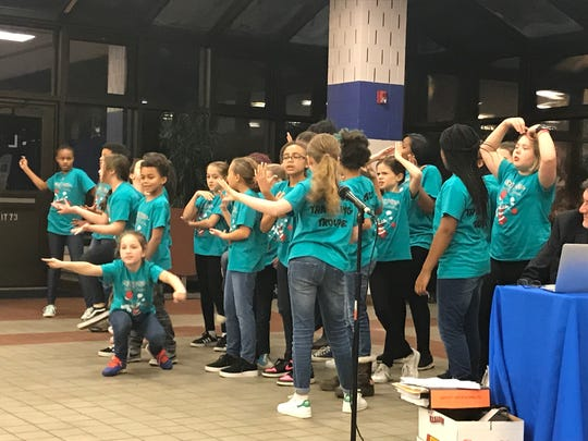 """Students from the Hillside School Traveling Troupe perform a selection from """"Seussical"""" during the Dec. 18 Montclair BOE meeting."""