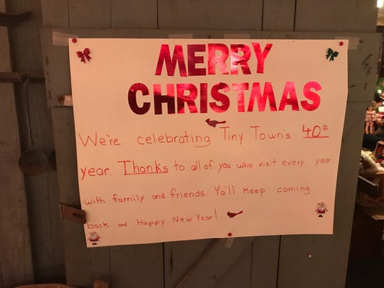 "A sign outside ""Santa's Workshop"" notes the 40th year"