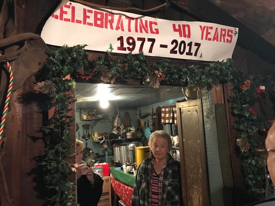 """Pat Kelly, daughter of the founder of Tiny Town, at the entrance to the kitchen in """"Santa's Workshop."""""""