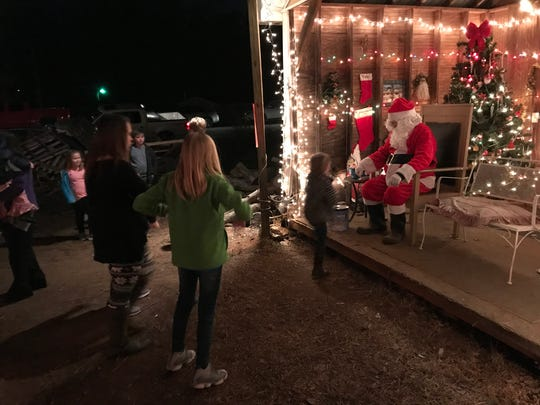 A child approaches Santa for a chat at Tiny Town.
