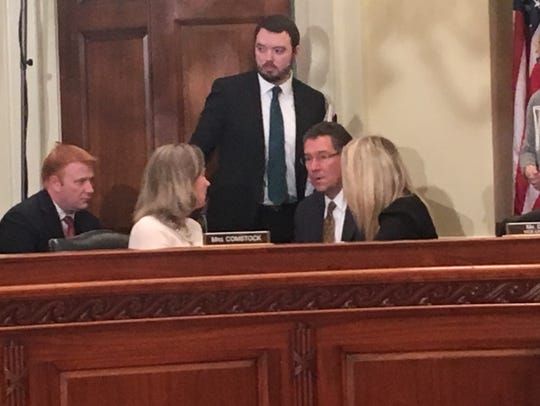 Rep. Barbara Comstock, R-Va., (left) and Rep. Gregg Harper, R-Miss., (right, seated) chat with staffers at a recent meeting of the House Administration Committee.