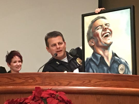Redding Police Chief Roger Moore, right, displays Nicole