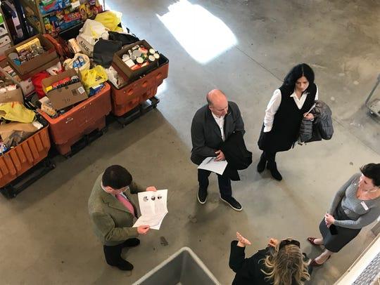 Representatives of the Gannett Foundation tour the
