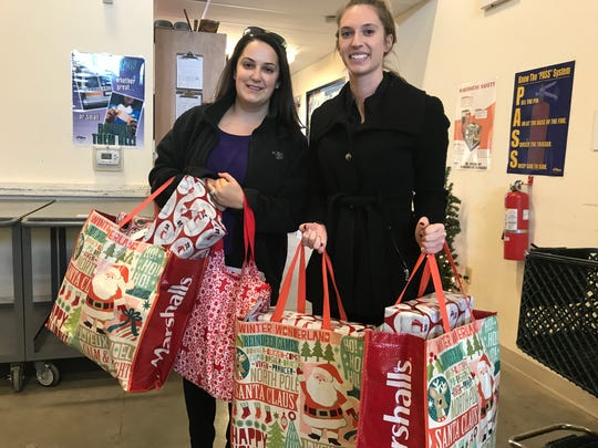 Employees of Met Life in Hanover drop off toys for