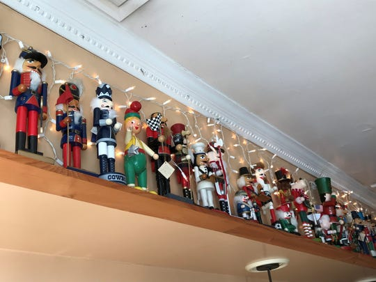 Nutcrackers line the walls of Fisher's Cafe in North Arlington, some of which were gifts from patrons.