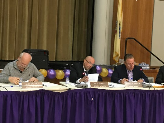 Members of the Garfield Board of Education.