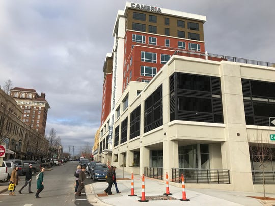 The recently opened Cambria hotel in downtown Asheville does have more rooms (136) than parking spaces in its deck (117), but Asheville has no specific requirements for parking downtown.