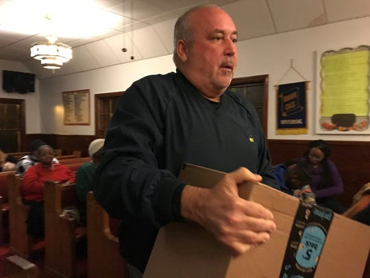 Timothy F. McConnell, 59 of Holmdel, delivers a package