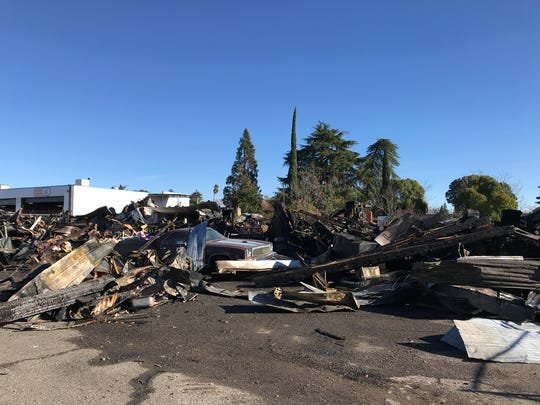 A fire that broke out Thursday night, Dec. 20, 2017,  burned down a warehouse on Fell Street in Redding. A woman staying inside the building was able to escape the flames with her dog.